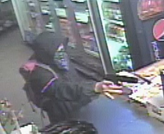 The gunman in the Beers & Babes robbery is described as Hispanic, 18 to 25 years old and approximately 5 feet 7 inches tall.
