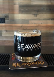 An 8-ounce pour of Imperial milk stout is seen in the tasting room at Seaward Brewing in Ventura.