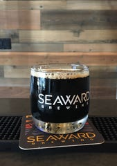 An 8-ounce pour of Imperial milk stout is seen in the tasting room at Seaward Brewing in Ventura. The new brewery also produces lagers and India pale ales.