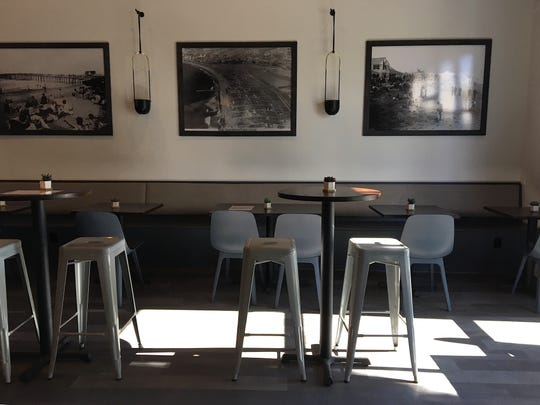 Decor in the Seaward Brewing taproom includes enlargements of photos showing Ventura as it looked in the 1930s and '40s.