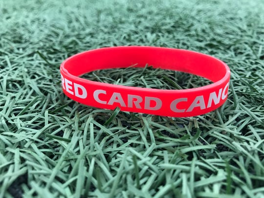 The Redwood High girls soccer program is selling a Red Card Cancer bracelet for $1 to fund raise money for cancer research.