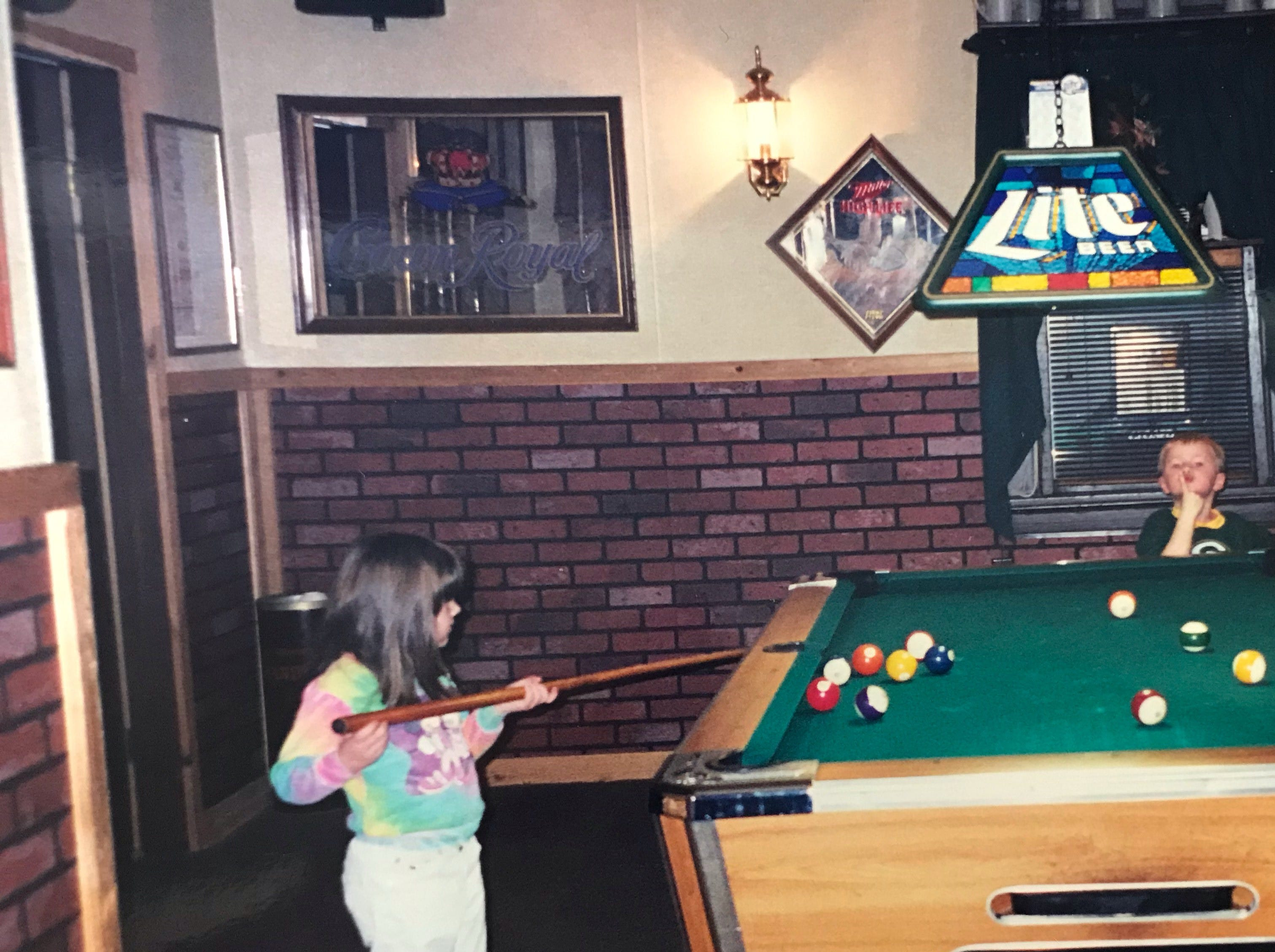 Children playing pool at Cheers Bar. Mary Jane Opper said it was a family-friendly and generational place.