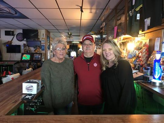 From left to right: Mary Jane Opper (owner), Bill Waraksa (bartender), Ashley Lewitzke (Opper's granddaughter)
