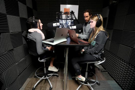 Evan Madin, an english and journalism teacher at Mamaroneck High School, works with seniors Rachel Leva and Kate Wise in the school's podcast recording studio Jan. 18, 2019. Mamaroneck offers a class in creating podcasts for seniors. The students in Madin's class are working on podcast stories based on a trip they took to West Virginia during the mid-term election season.