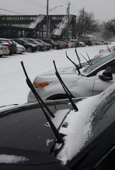 Commuters leave their windshield wipers in the up position at the Metro-North train station in Tarrytown when it snows.
