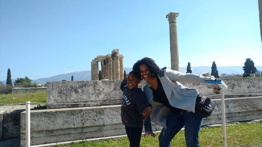 South Nyack residents Cylinda Whitted and her son, Noble, embrace history in Athens.