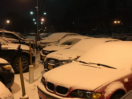 Snow covered cars at the Larchmont train station on Jan. 18, 2019.