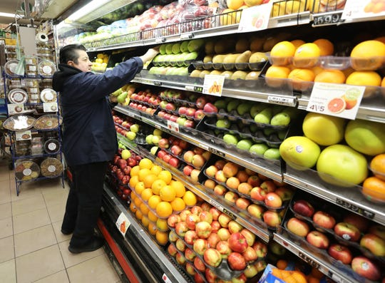 Juan Reyes arranges the fruit section in the DeCicco Marketplace on East Parkway in Scarsdale, Jan. 18, 2019.