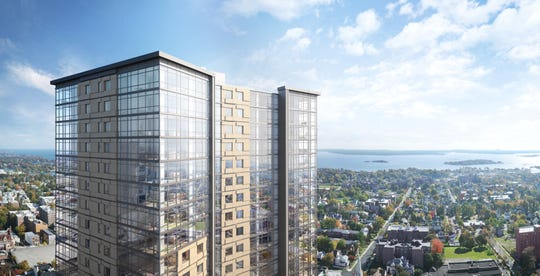 Rendering of RXR's 28-story mixed-use tower on the former Loew's Theatre site at 587 Main St., New Rochelle. The project, to be called 360 Huguenot, is expected to start leasing this year.