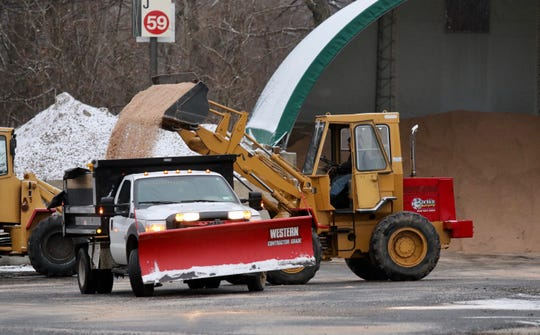 A bucket loader operator dumps road salt into a dump truck at the Palisades Center mall commuter lot in West Nyack. on Friday, Jan. 18, 2019.