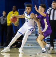Delaware's Eric Carter pushes toward the hoop against James Madison's Zach Jacobs in the first half at the Bob Carpenter Center Thursday.