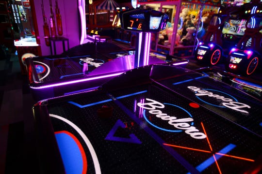 The reinvigorated Bowlero - formerly the AMF Price Lanes - features retro-surfer styling, video panels and blacklight lanes.