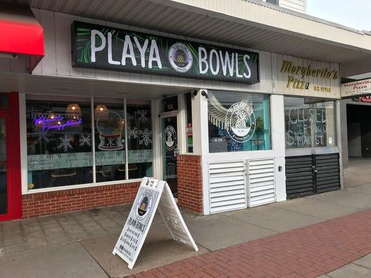 The outside of the Playa Bowls casual restaurant in Newark.