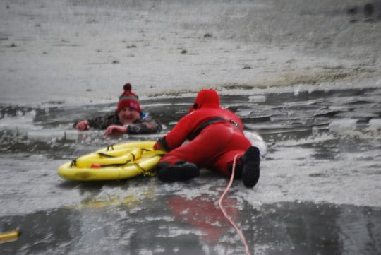 A man was rescued from an icy pond in Carousel Park Friday afternoon.