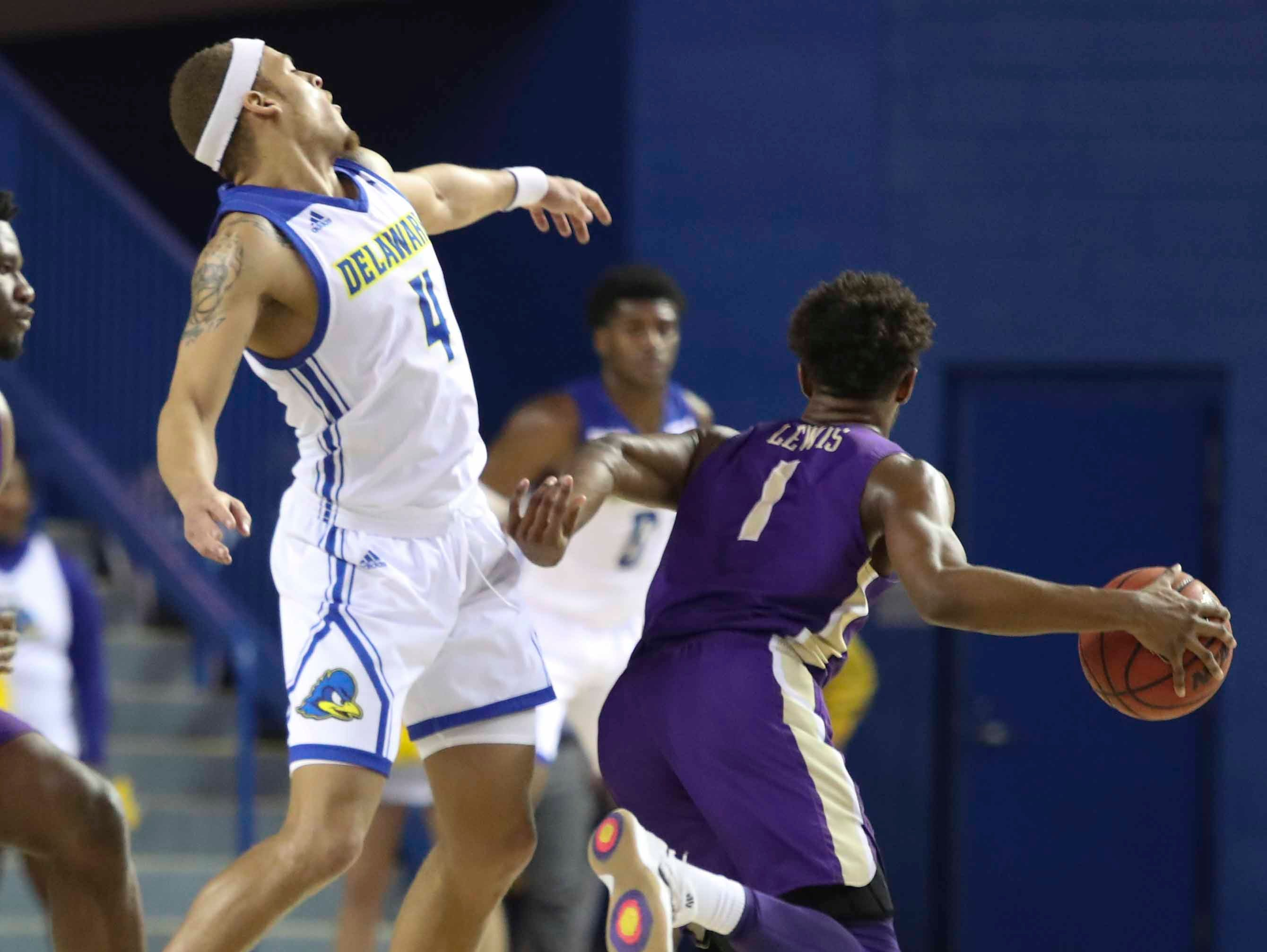 Delaware's Darian Bryant reacts after contact with James Madison's Matt Lewis in the first half at the Bob Carpenter Center Thursday.