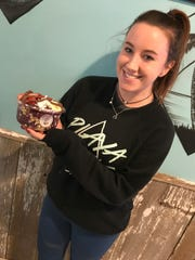 Alex Glassheim, co-manager of the Newark Playa Bowls, holds up an acai bowl she created. Glassheim, a University of Delaware graduate, will run the new Rehoboth Beach Playa Bowls when it opens in spring.