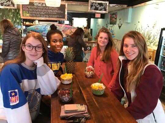 From left, Reid Reckner, a student at Westchester University, joins her University of Delaware friends Naarah Anderson, Tara Jensen and Grace DeWhitt at the Newark Playa Bowls.