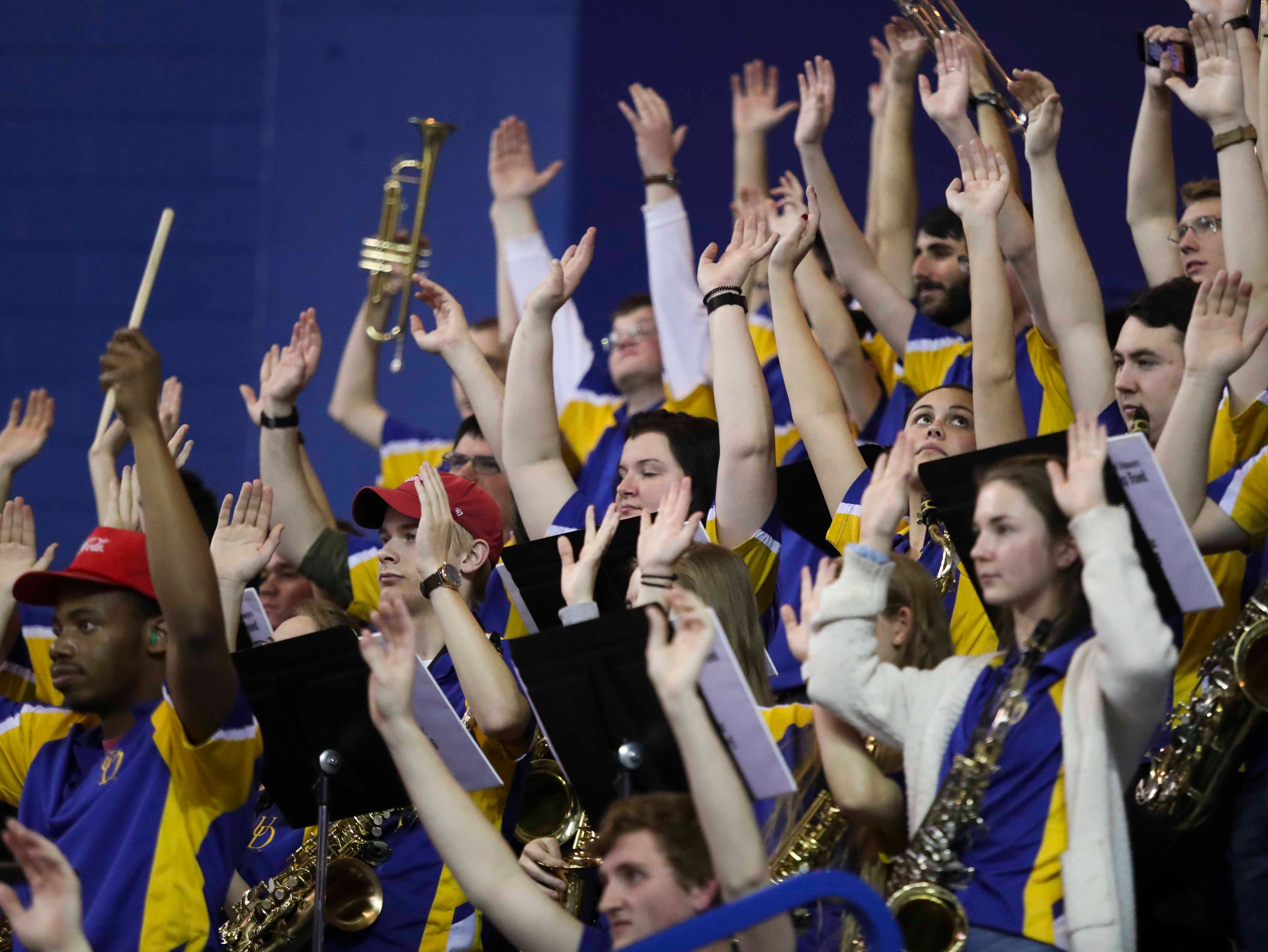 The UD pep band watches as a Blue Hen shoots free throws in the first half at the Bob Carpenter Center Thursday.