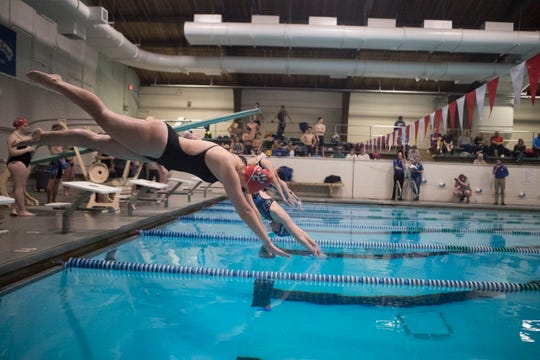 Action from the Conrad vs. Caesar Rodney swimming and diving meet Jan. 17 at McKean High. The Conrad boys defeated Caesar Rodney 100-76, while the Caesar Rodney girls defeated Conrad 102-73.