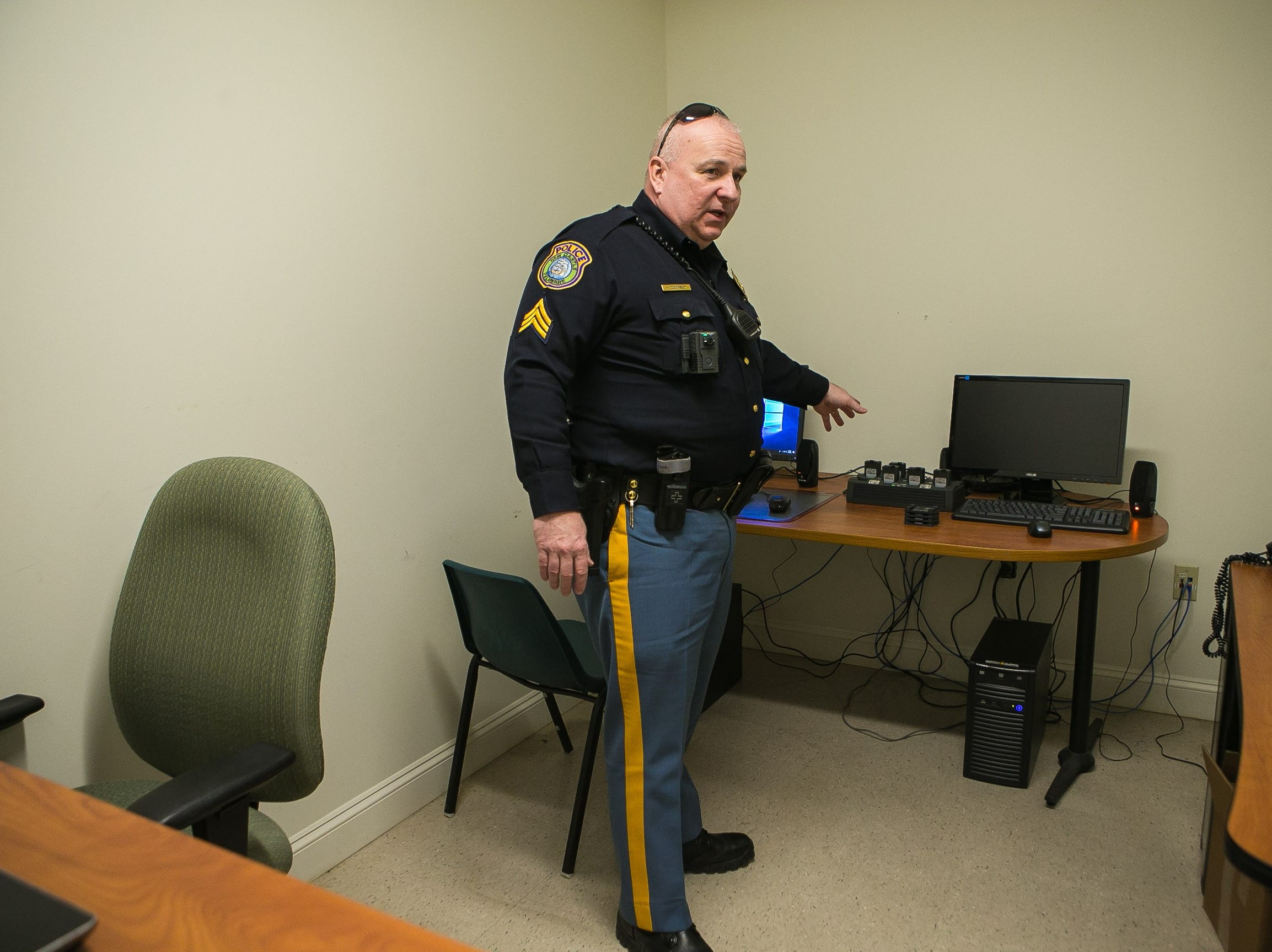 New Castle Police Sgt. Keith Dempsey gives a tour of the police department and showing their newly acquired body cam.