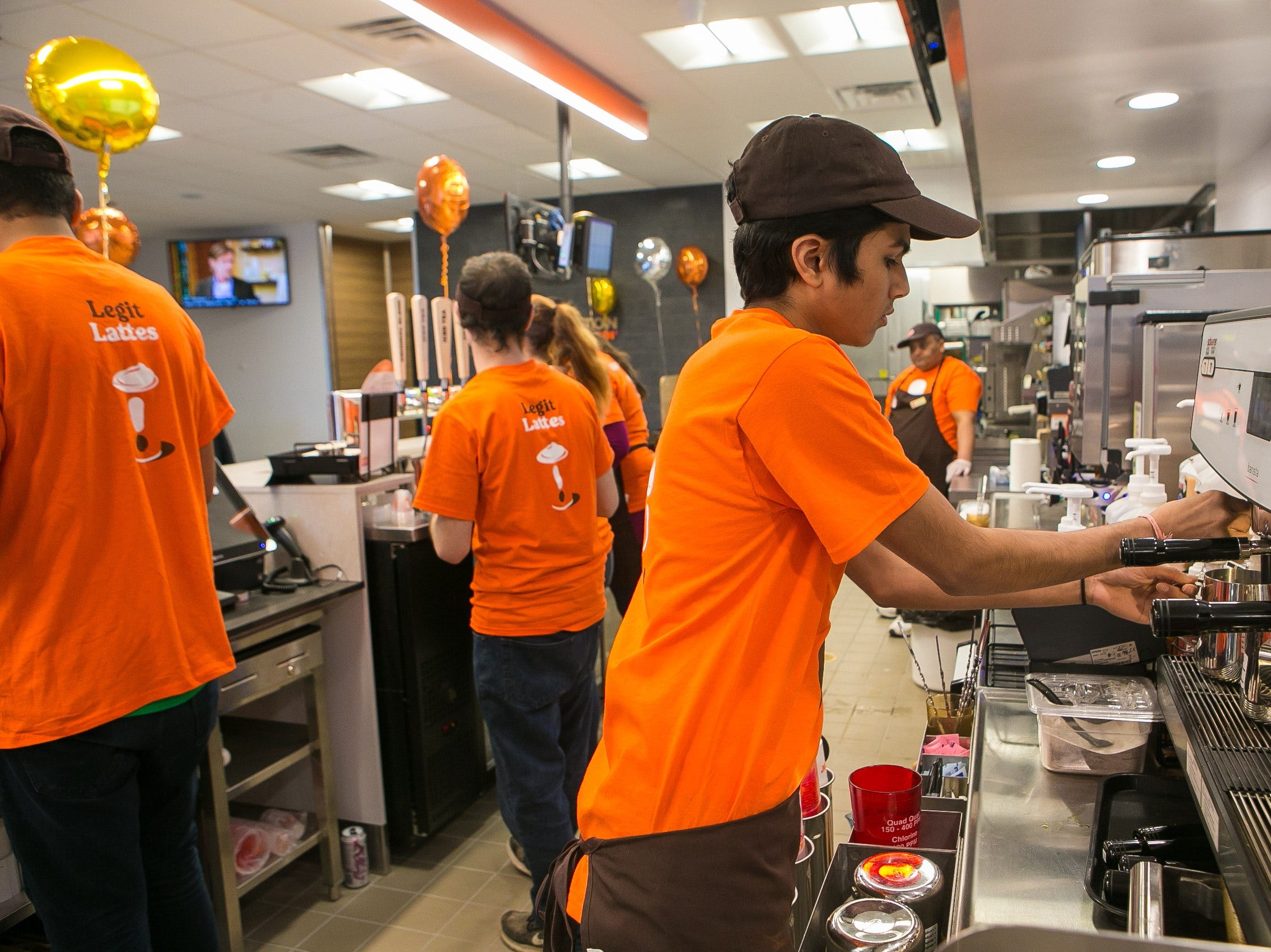 Neil Patel prepares an order on the new espresso machine. The Dunkin' chain, formerly known as Dunkin' Donuts, has opened one of its first new 'concept' stores today in north Wilmington on Naamans Road.