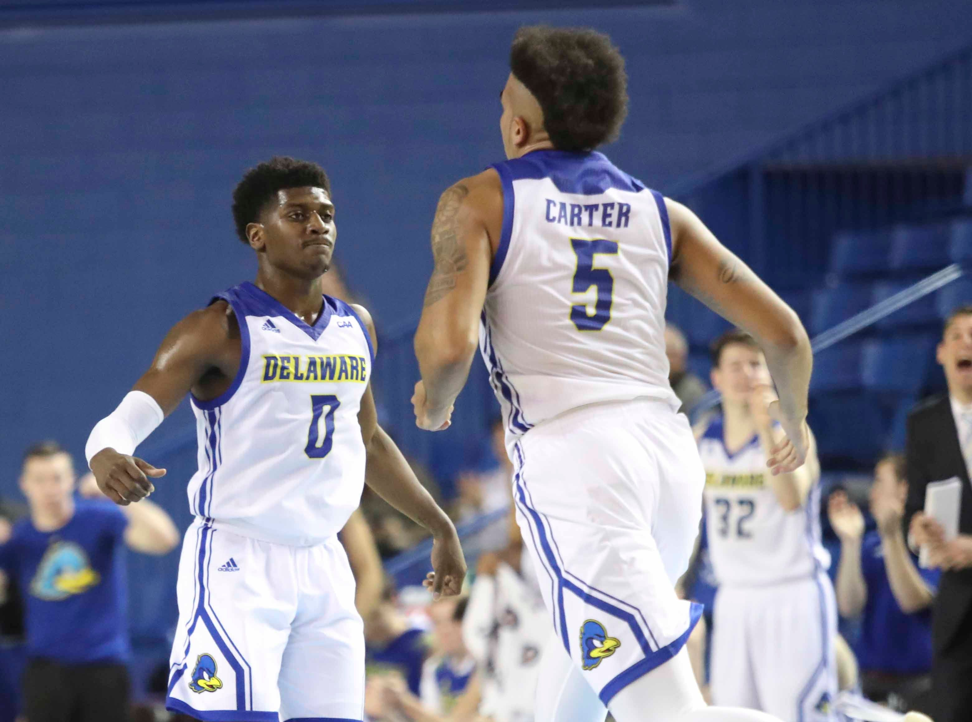 Delaware's Ryan Allen (0) heads back on defense with Eric Carter after Carter scored in the first half at the Bob Carpenter Center Thursday.