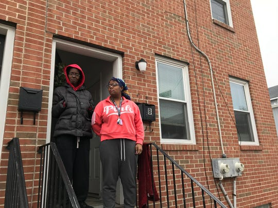 Mildred Cropper and her daughter Diamond Sharp stand outside their federally subsidized apartment in Wilmington's West Center City