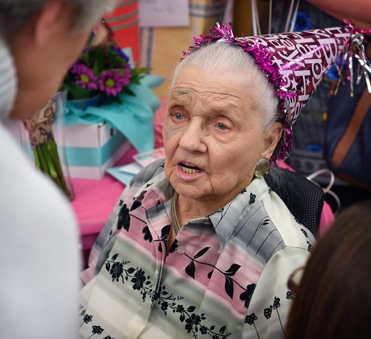 Ilma Lucille Craft visits with guests at her 100 year-old birthday party Friday afternoon at Advanced Rehabilitation and Healthcare.