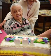 Ilma Lucille Craft prepares to blow out the candles on her birthday cake Friday. Craft turned 100 years old and her friends and staff at Advanced Rehabilitation and Healthcare threw her a party.