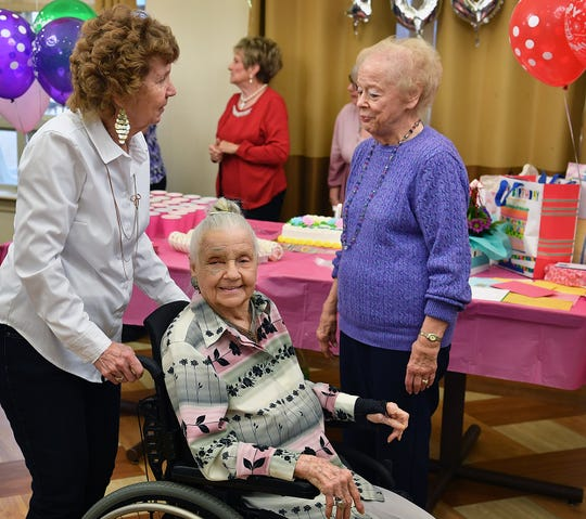 Ilma Lucille Craft arrives at her birthday party Friday afternoon as friends, family and staff at Advanced Rehabilitation and Healthcare celebrate her turning 100 years-old.