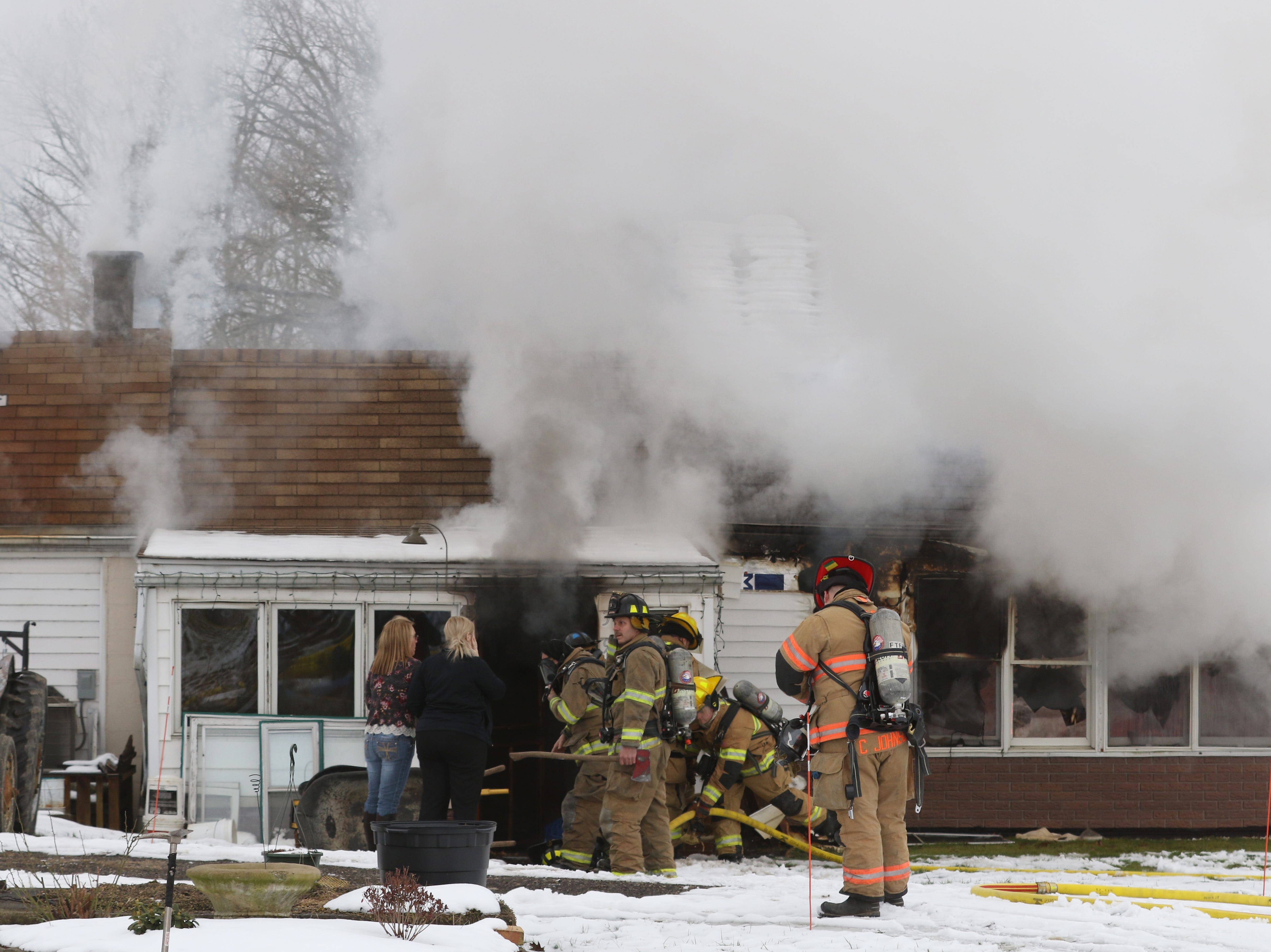 Fire damaged the home at 3950 Holbein Drive in Falls Township on Friday. Several animals died in the blaze but no one was injured. Falls and Washington Townships and Zanesville fought the fire.