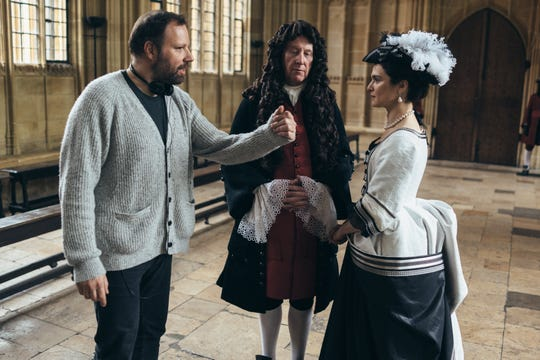"""Director Yorgos Lanthimos, left, confers with actors James Smith and Rachel Weisz on the set of """"The Favourite,"""" which was named the year's best British film at the BAFTAs."""