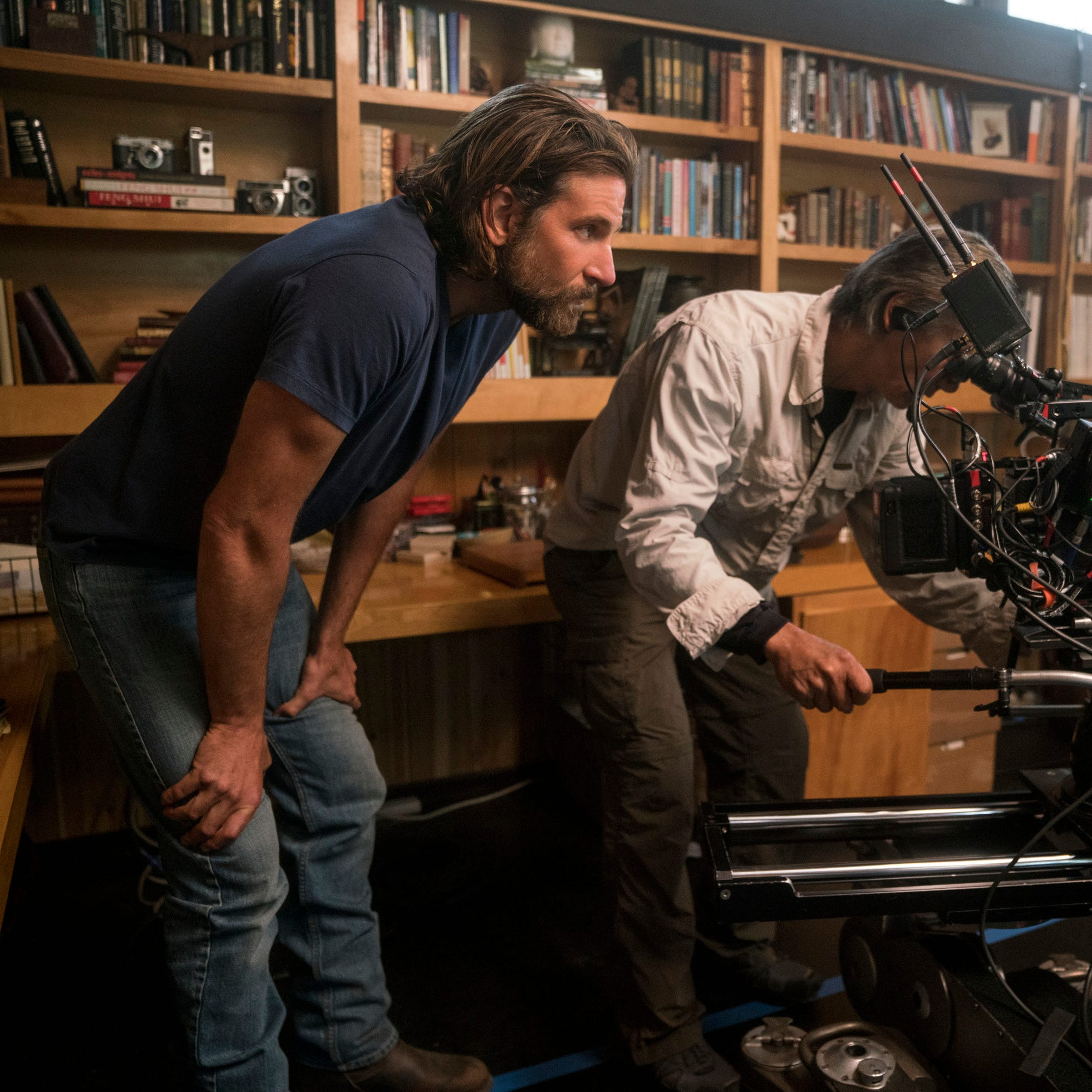 """This image released by Warner Bros. Pictures shows director/co-writer/producer Bradley Cooper, left, and camera operator Scott Sakamoto on the set of """"A Star is Born."""" Cooper, Alfonso Cuaron and Spike Lee are among the nominees for the Director's Guild award for outstanding directorial achievement. The DGA announced its five nominees Tuesday in one of the most closely watched guild awards leading up next month's Academy Awards.  (Clay Enos/Warner Bros. via AP) ORG XMIT: NYET206"""