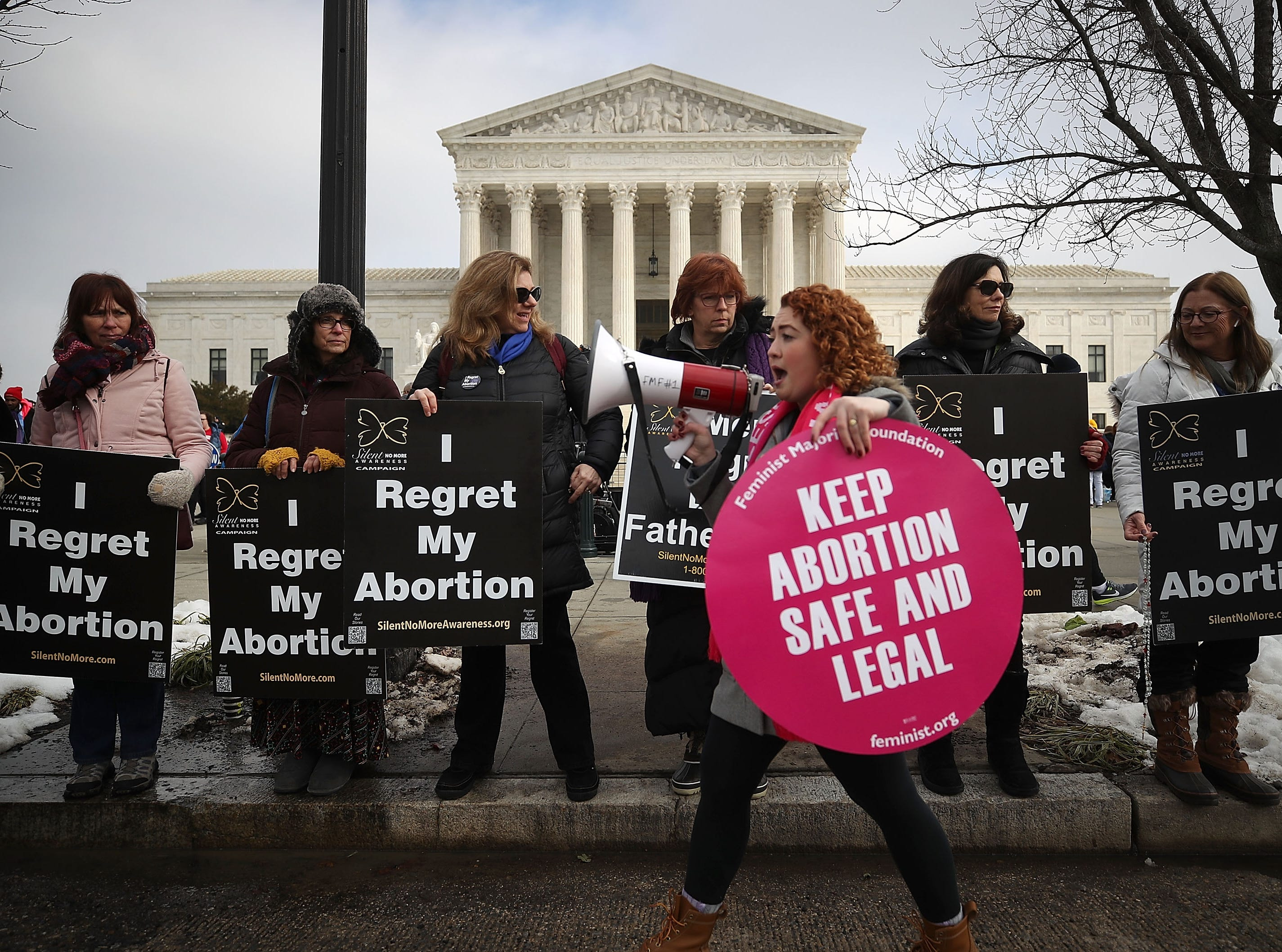 Protesters on both sides of the abortion issue gather in front of the U.S. Supreme Court building during the Right To Life March, on Jan. 18, 2019 in Washington, DC. The Right to Life Campaign held its annual March For Life rally and march to the U.S. Supreme Court protesting the high court's 1973 Roe V. Wade decision making abortion legal.