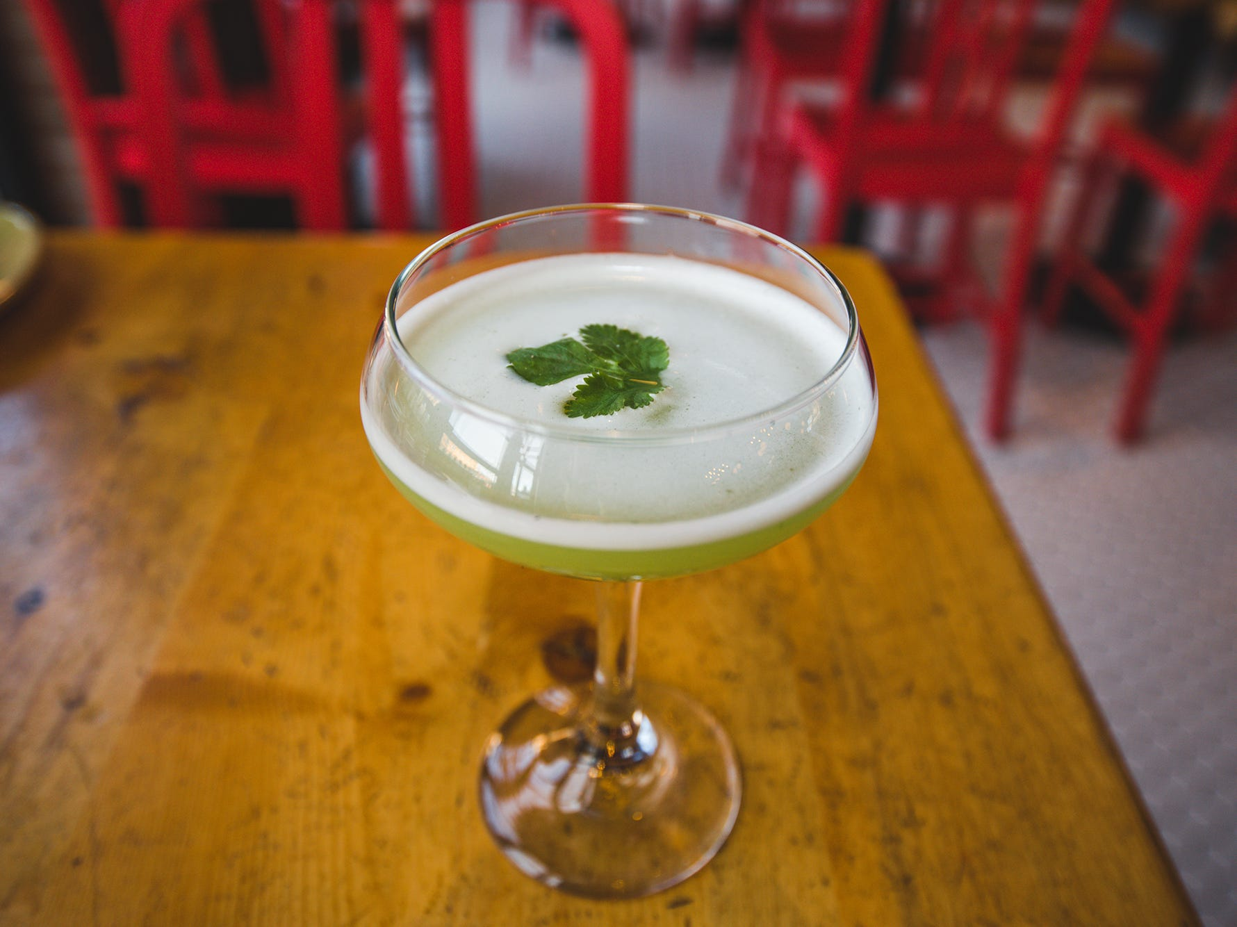 The Cilantro Fizz at Punch Bowl Social locations across the U.S. It's crafted from fresh cilantro, house-made jalapeño and cucumber syrup, fresh lime juice and aquafaba.