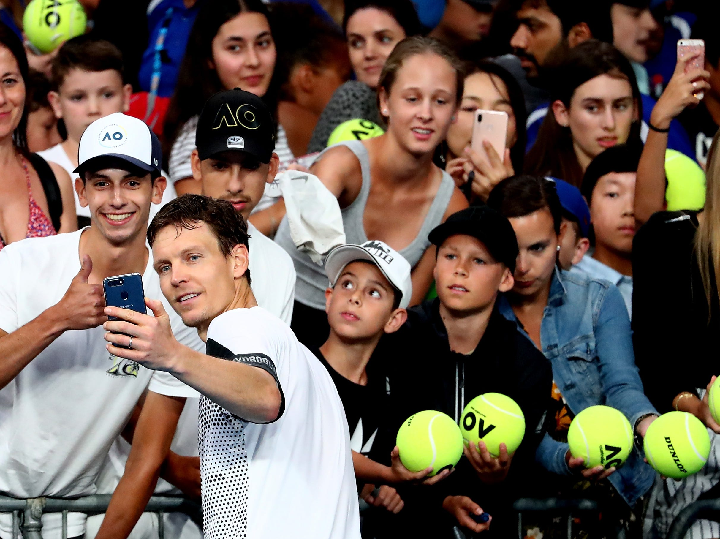 Tomas Berdych of the Czech Republic poses for a selfie with fans after upsetting No. 18 seed Diego Schwartzman of Argentina in the third round.