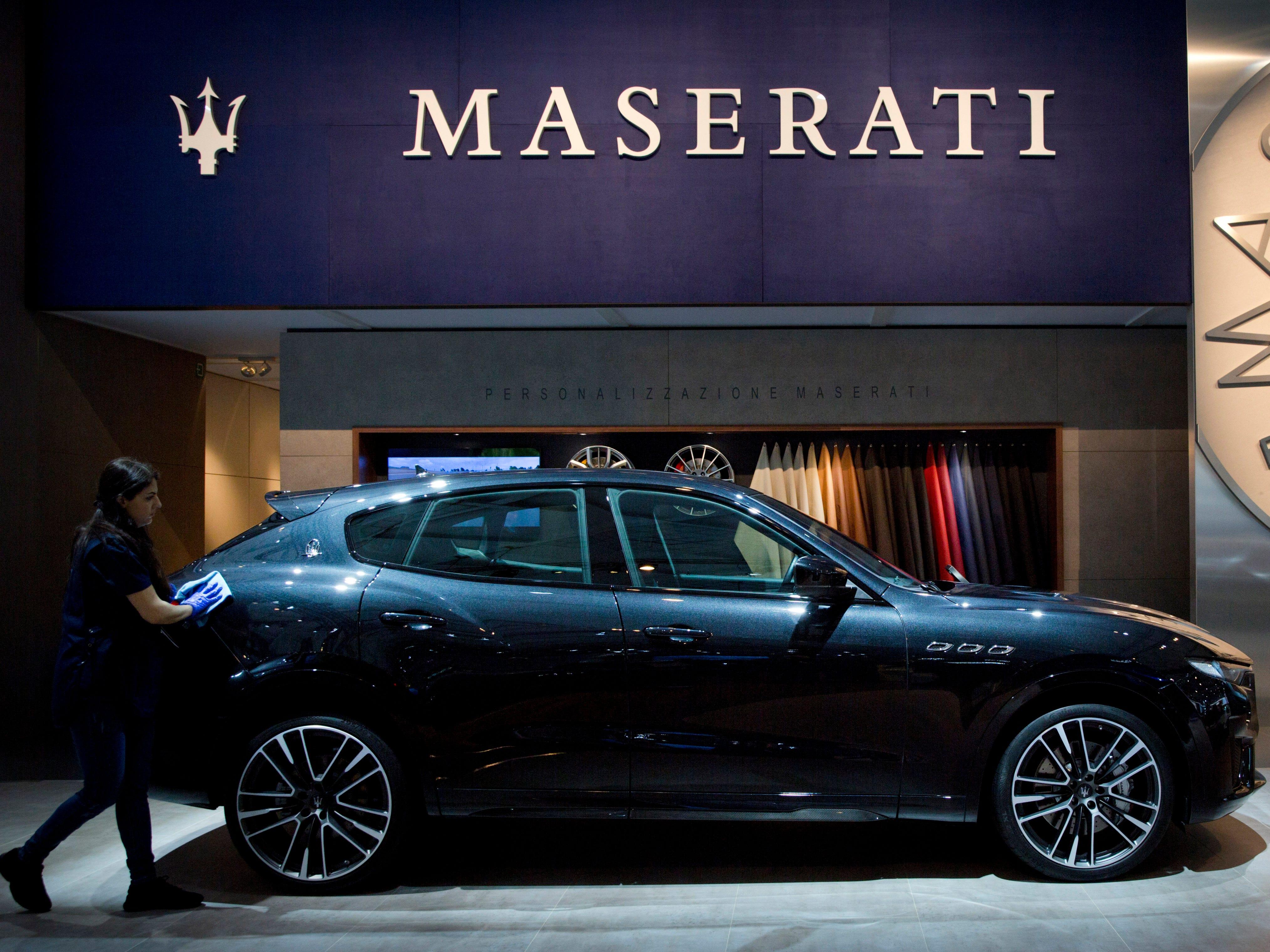 A worker polishes the new Maserati Levante.