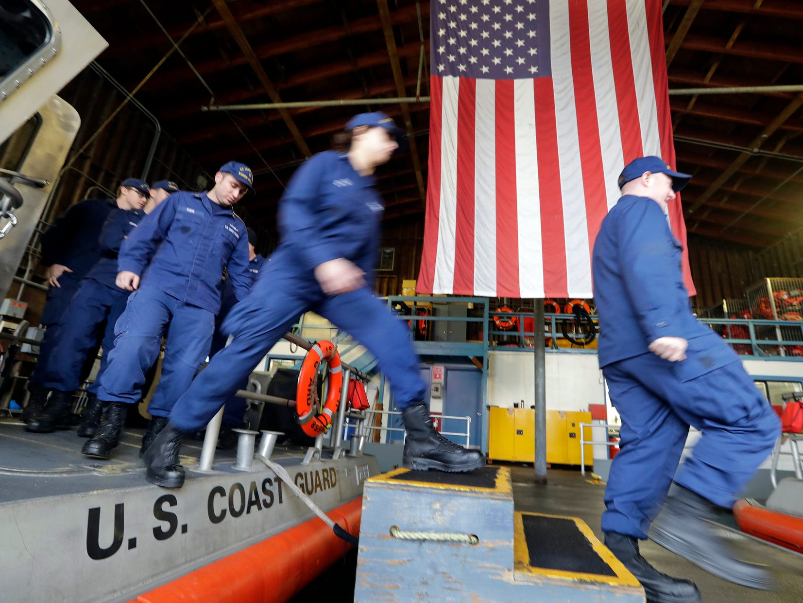 FILE In this Wednesday, Jan 16, 2019, file photo, U.S. Coast Guardsmen and women, who missed their first paycheck a day earlier during the partial government shutdown, walk off a 45-foot response boat during their shift at Sector Puget Sound base in Seattle. San Antonio-based USAA, a military personnel insurer and financial services company, said Wednesday they has donated $15 million for interest-free loans to Coast Guard members during the partial U.S. government shutdown. The funds will be disbursed by Coast Guard Mutual Assistance. The American Red Cross Hero Care Center will assist. (AP Photo/Elaine Thompson, File) ORG XMIT: CER303