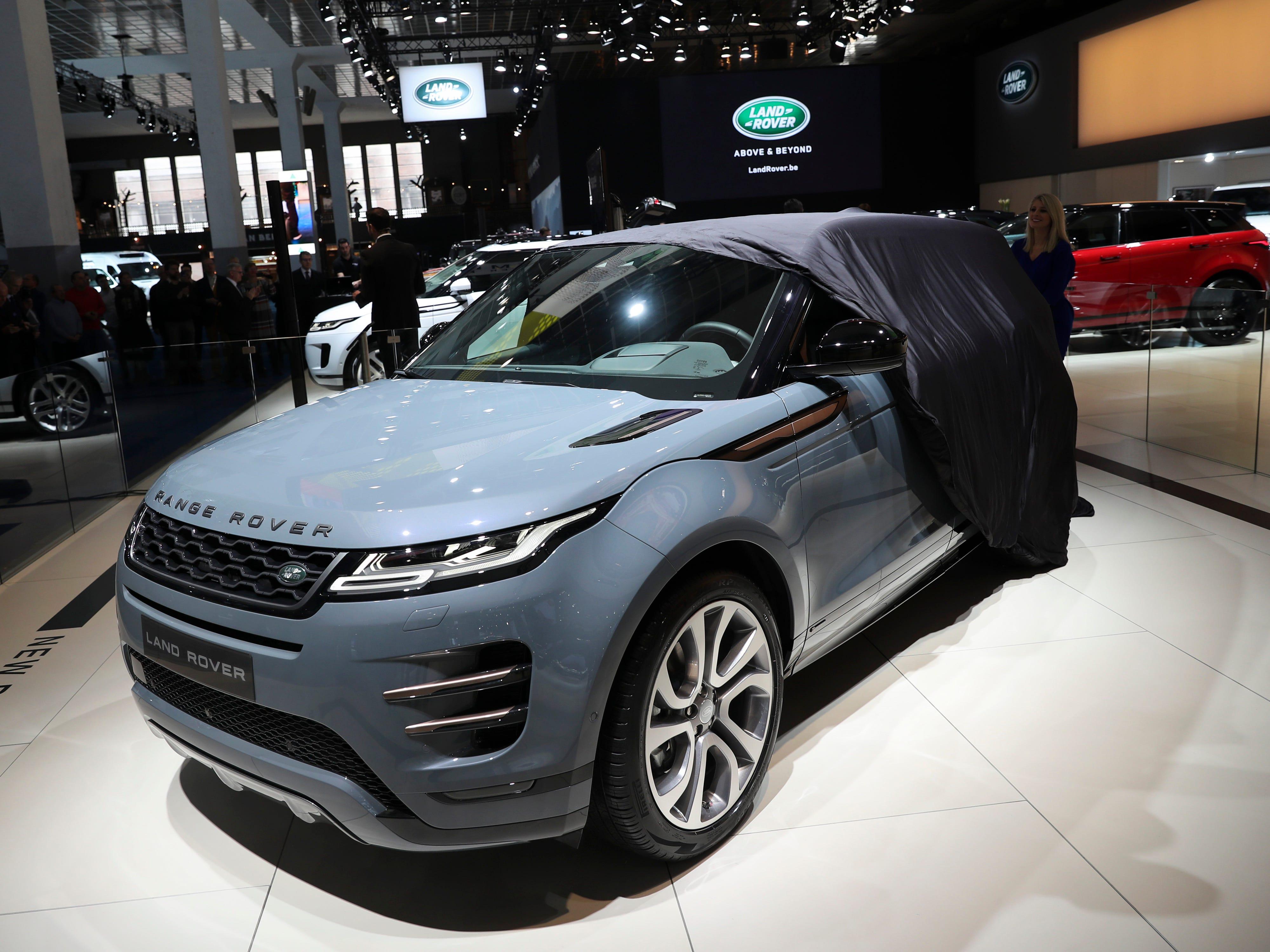 An employee unveils the new Range Rover Evoque.