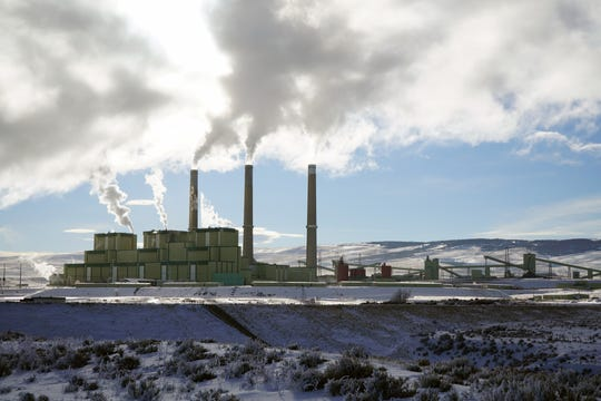"The three generating ""units"" of the Craig Station coal-fired power plant send steam into the air on a cold January morning. The power plant, and another one to the east, are powered by coal mined nearby."