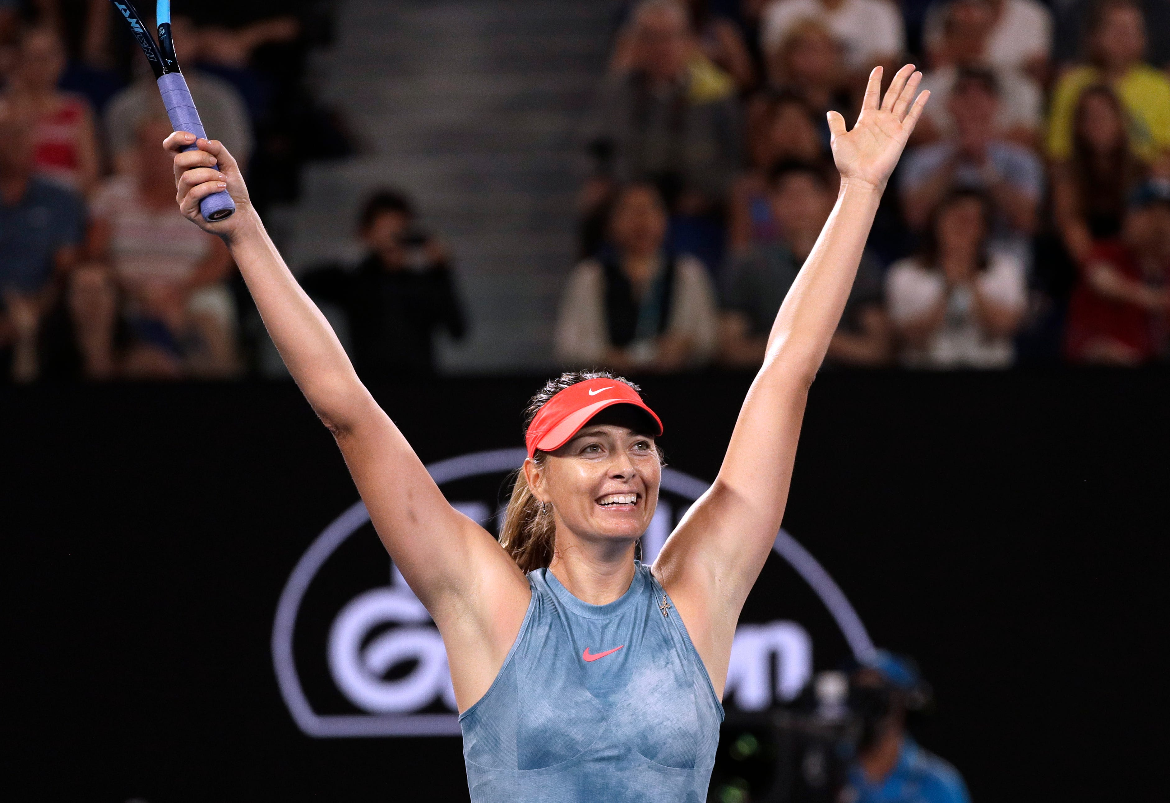Maria Sharapova celebrates after defeating Caroline Wozniacki at the Australian Open.