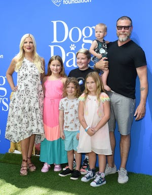 "Tori Spelling, Dean McDermott and their five children arrive at the premiere of ""Dog Days"" at Westfield Century City on August 5, 2018, in Century City, California."