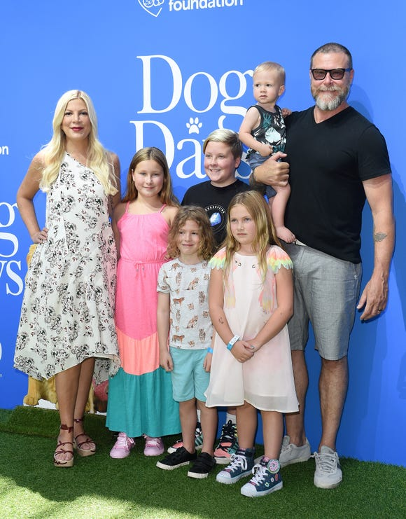 """Tori Spelling, Dean McDermott and their five children arrive at the premiere of """"Dog Days"""" at Westfield Century City on August 5, 2018, in Century City, California."""