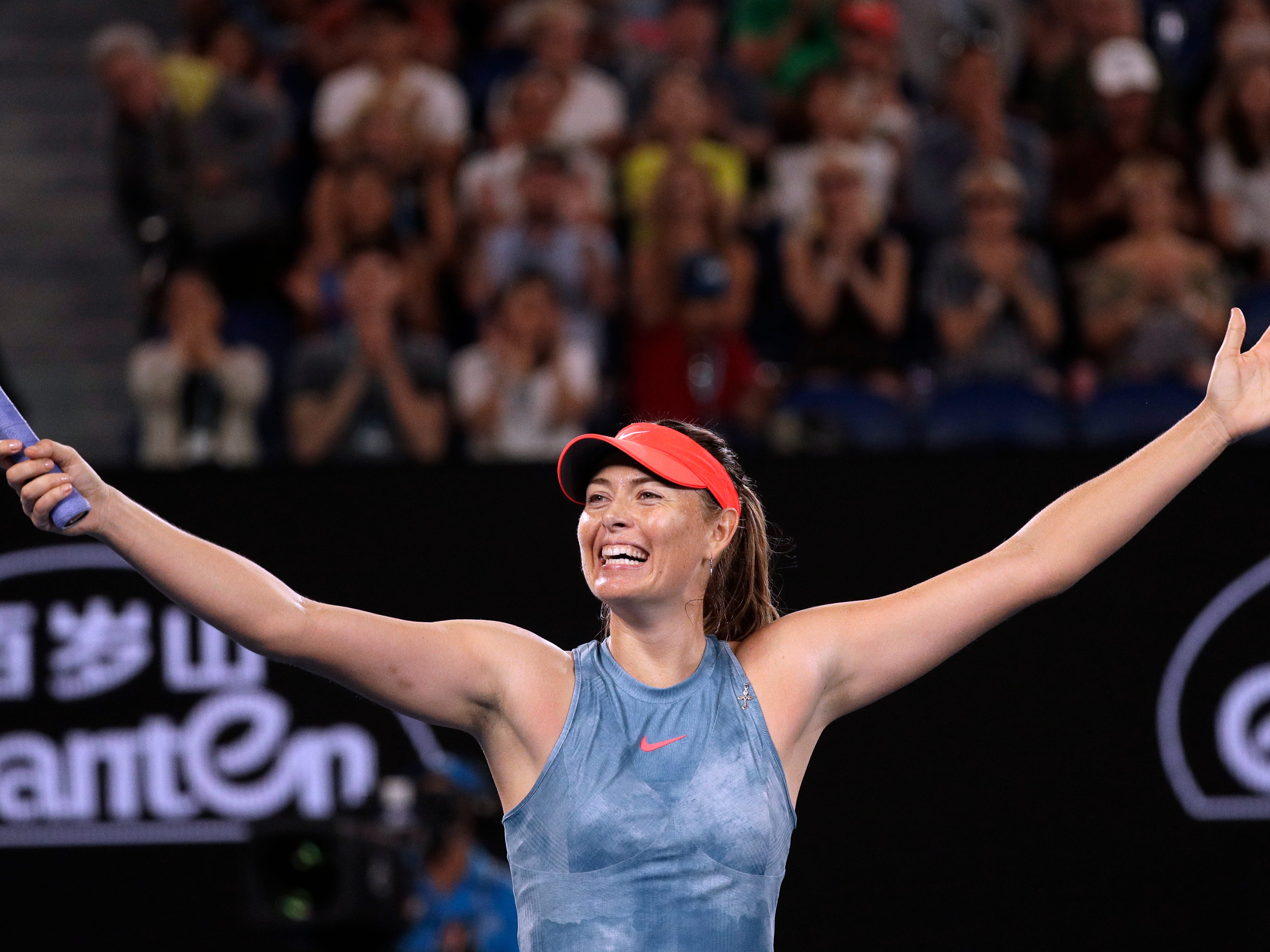 Maria Sharapova celebrates after defeating defending Australian Open champion Caroline Wozniacki in their third round match.