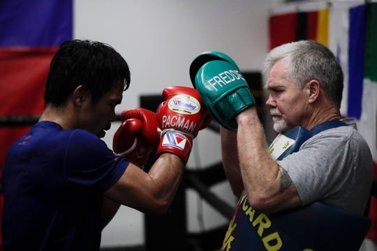 Manny Pacquiao, left, trains with Freddie Roach in preparation for Saturday's fight in Las Vegas.