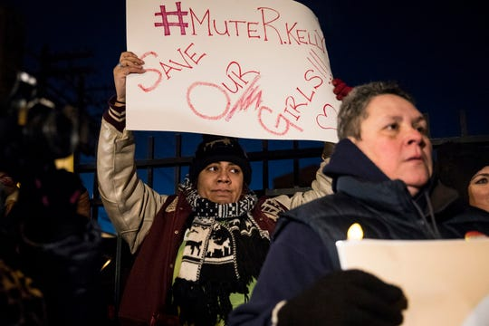 #MuteRKelly supporters protest outside R. Kelly's rented Chicago studio,  Jan. 9, 2019, in Chicago.