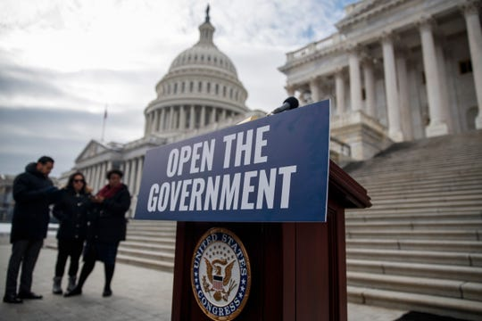 epa07290591 A sign hangs on the podium prior to a Senate Democrats press conference urging US President Trump to reopen the government outside the US Capitol Capitol in Washington, DC, USA, 16 January 2019. Senate democrats outlined effects the shutdown, now in its 25th day, is having on American workers and families and called on President Trump to reopen the government immediately.  EPA-EFE/SHAWN THEW ORG XMIT: STX17
