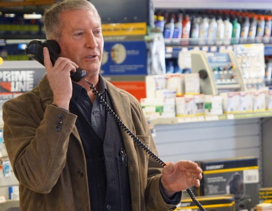 Craig, Colorado, Mayor John Ponikvar chats with a caller while working at his NAPA auto parts store.