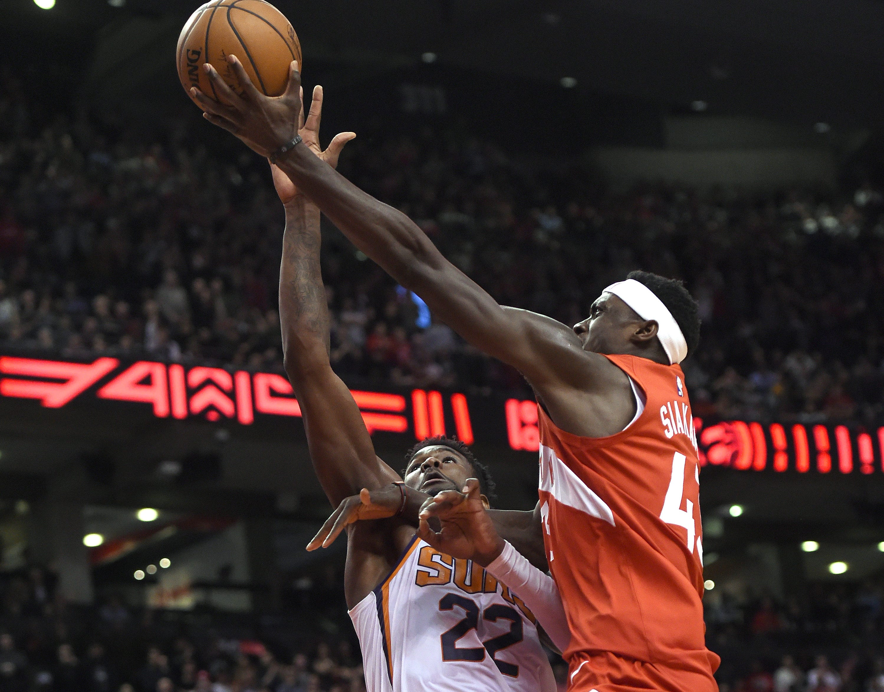 Jan. 17: Raptors forward Pascal Siakam (43) drives and puts in the winning bucket at the buzzer over Suns defender Deandre Ayton (22) in Toronto.
