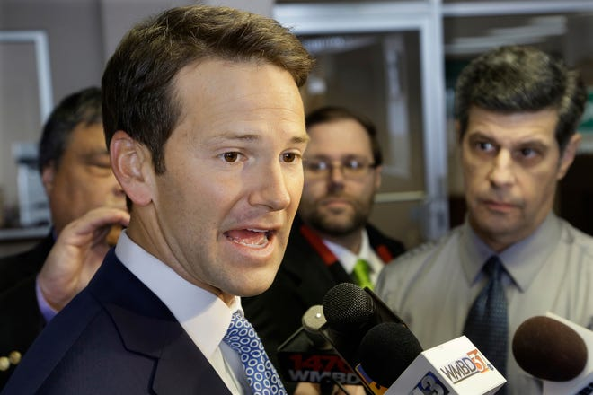 """Illinois Rep. Aaron Schock speaks to reporters in Peoria, Ill., in 2015. He later resigned and was indicted on fraud charges after remodeling his Capitol Hill office in the style of the television series """"Downton Abbey."""""""